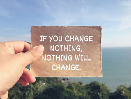 Motivational and inspirational wording - If You Change Nothing, Nothing Will Change. Blurred styled background.