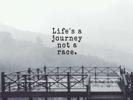 Motivational and inspirational wording - Life's a journey not a race. Blurred styled background.