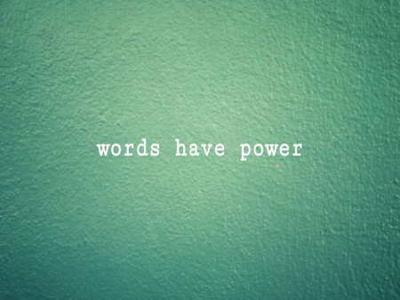 Motivational and inspirational wording - Words Have Power written on green wall background.