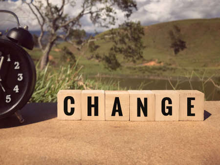 Motivational and inspirational word - CHANGE written on wooden blocks. Blurred styled background.