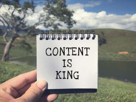 Motivational and inspirational wording - Content Is King written on a notepad.