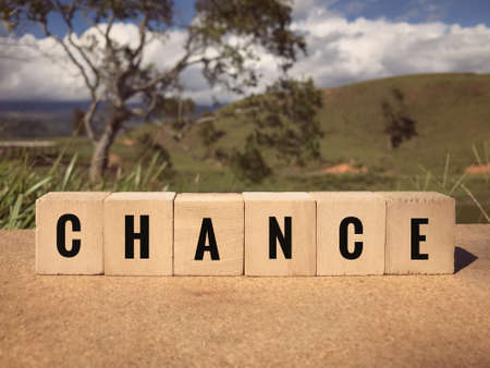 Motivational and inspirational word - CHANCE written on wooden blocks. Blurred styled background.