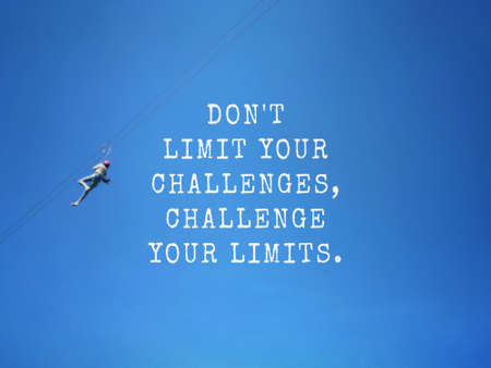Motivational and inspirational wording - Don't Limit Your Challenges, Challenge Your Limits. Blurred styled background. Stock Photo