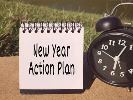 New Year Plan concept - New Year Action Plan written on a notepad.