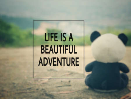 Motivational and inspirational wording -Life Is A Beautiful Adventure. Blurred styled background.
