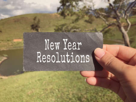 New year resolutions concept - New Year Resolutions written on a notepad. Stock Photo
