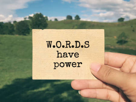 Motivational and inspirational wording - Words Have Power written on a paper. Blurred styled background. Stock Photo