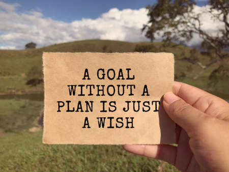 Motivational and inspirational wording - A Goal Without A Plan Is Just A Wish. Vintage styled background.