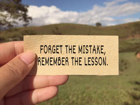 Motivational and inspirational wording - Forget The Mistake, Remember The Lesson. Blurred styled background.