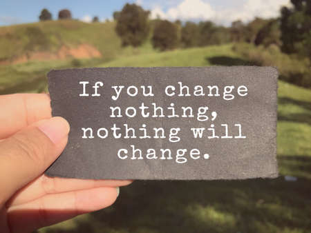 Motivational and inspirational wording - If You Change Nothing, Nothing Will Change written on a paper. Blurred styled background.