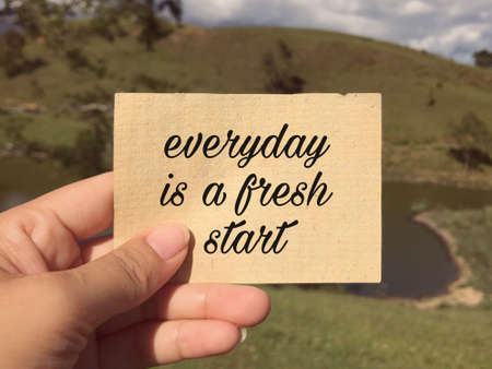 Motivational and inspirational wording - Everyday Is A Fresh Start written on a paper. Blurred styled background.