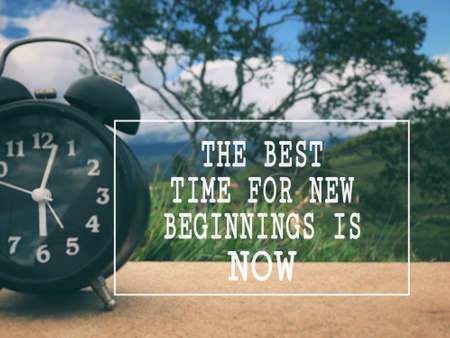 Motivational and inspirational wording - The Best Time For New Beginnings Is Now. Blurred styled background. Stock Photo