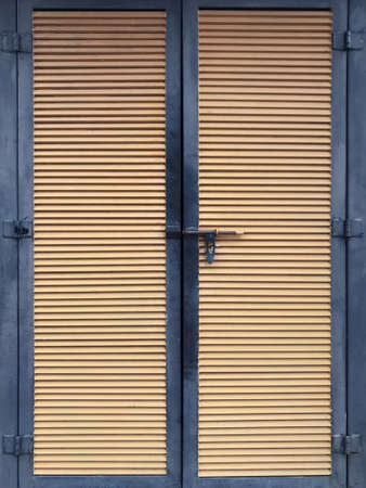 Closed wooden door of a building. Stock Photo