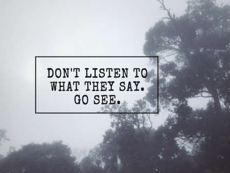 Motivational and inspirational wording - Don't listen to what they say. Go see. Blurred styled background.