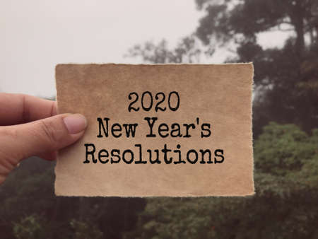 New year resolutions concept - 2020 New Year's Resolutions written on a paper. Blurred styled background.