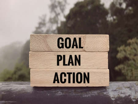 Motivational and inspirational words - Goal, Plan, Action written on wooden blocks. Stock Photo
