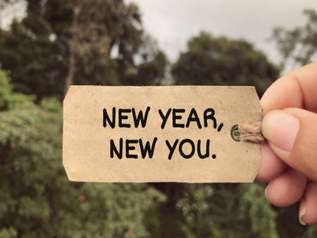 Motivational and inspirational wording - New Year, New You written on a tagging paper.