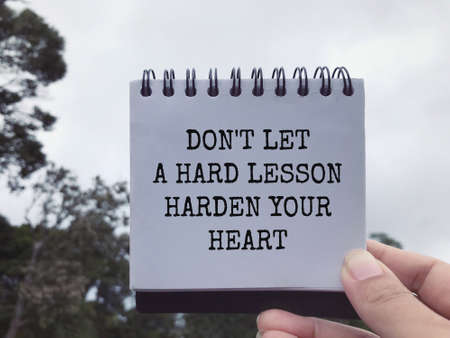 Motivational and inspirational wording - Don't Let A Hard Lesson Harden Your Heart. Blurred styled background.