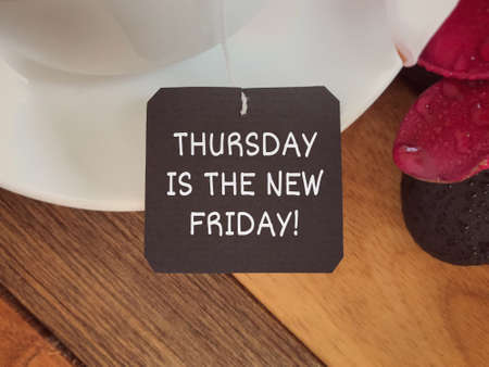 Motivational and inspirational wording - Thursday Is The New Friday Written on a paper. Stock Photo