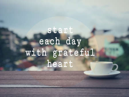 Motivational and inspirational wording - Start Each Day With Grateful Heart. Blurred vintage styled background.