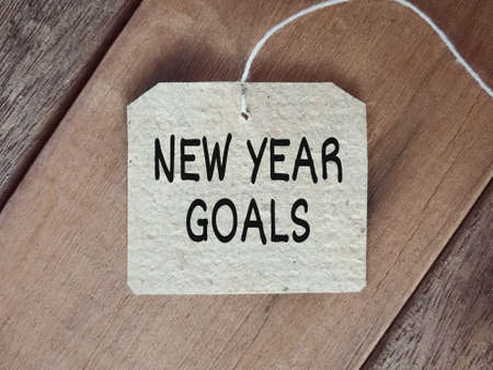 New year resolutions concept - New Year Goals written on a paper.