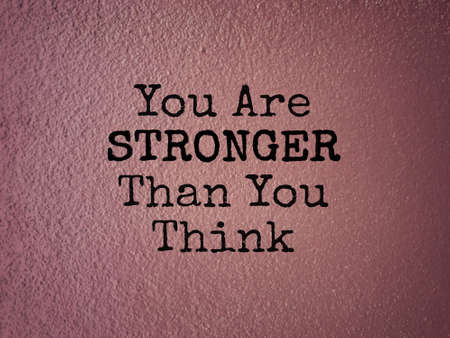 Motivational and inspirational wording - You Are Stronger Than You Think. Blurred styled background. Stock Photo