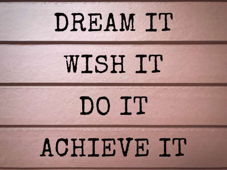 Motivational and inspirational wording - Dream It, Wish It, Do It, Achieve It written on wooden plates.