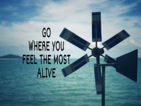 Motivational and inspirational wording - Go Where You Feel The Most Alive. Blurred styled background. Stock Photo