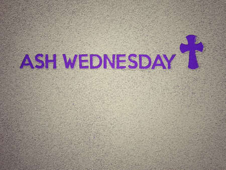Ash Wednesday, Lent Season and Holy Week concept. Ash Wednesday wording and Christian Holy cross shape on background of scattered ashes.