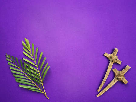 Good Friday, Palm Sunday, Ash Wednesday, Lent Season and Holy Week concept.  Palm leaves and crosses made of palm leaves on purple background.