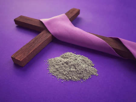Good Friday, Lent Season, Ash Wednesday and Holy Week concept. Christian cross and ashes on purple background. Archivio Fotografico