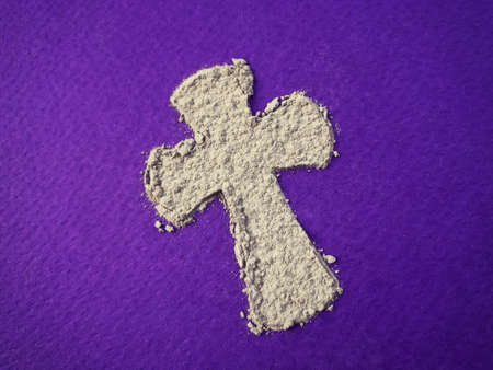 Ash Wednesday, Lent Season and Holy Week concept. A Christian Holy cross shape on background of scattered ashes. Archivio Fotografico