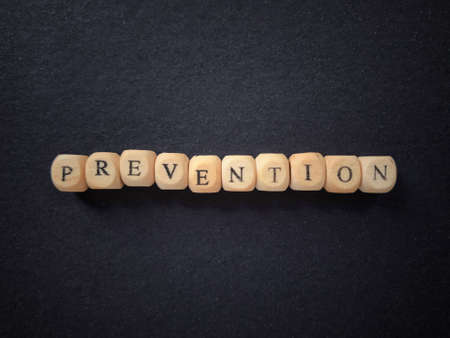 Health care and medical concept. PREVENTION written on wooden blocks. Blurred styled background. 版權商用圖片