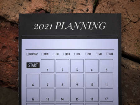 New Year resolution concept. 2021 PLANNING written on a book planner. Archivio Fotografico