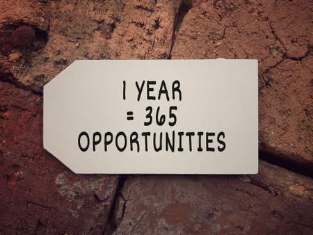 New Year resolution concept. 1 Year = 365 Opportunities written on a small white board.