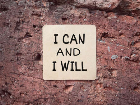 Motivational and inspirational wording. I CAN AND I WILL written on a paper. Archivio Fotografico