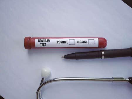 Health care and medical concept. COVID-19 TEST with result options written on a test tube.