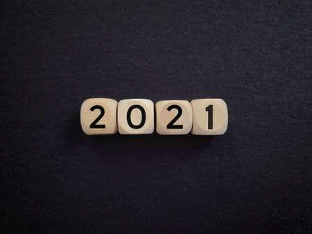 2021 written on wooden blocks. Vintage styled
