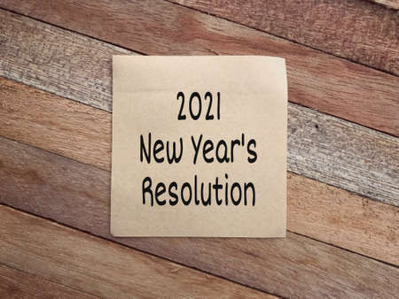 New Year resolution concept. 2021 New Year's Resolution written on a paper. Vintage styled background.