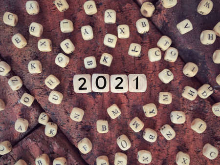 Time and year concept. 2021 written on wooden blocks. Vintage styled background. Archivio Fotografico
