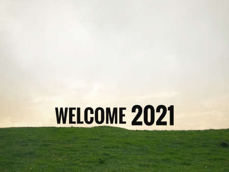 New Year concept. WELCOME 2021 written on blurred background of a hill. 版權商用圖片