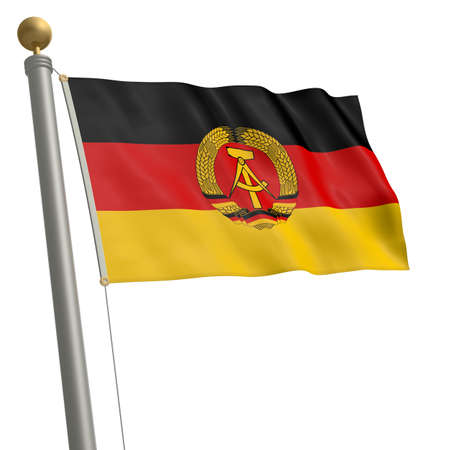 The flag of GDR fluttering on flagpole