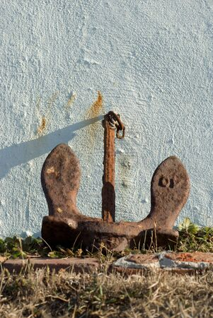rusting: Rusting steel anchor decorates the garden of the Battery Point lighthouse in Crescent City, CA.