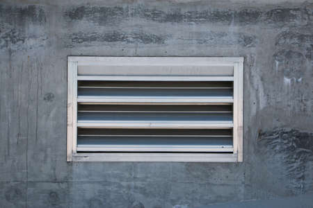 louvered: Air Vent in Concrete Wall