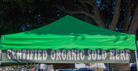 Certified Organic Sold Here Sign Under Tent