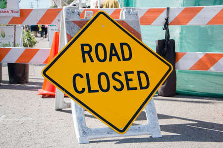 road closed: Road Closed Sign with Barricade in Background Stock Photo