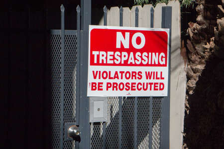 trespassing: No Trespassing Sign on Gate Stock Photo