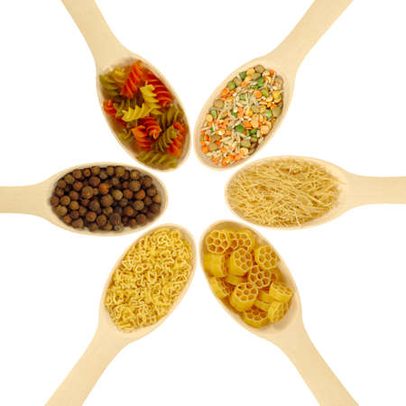 Isolated image of spoons with noodles, spices and dry mixtures