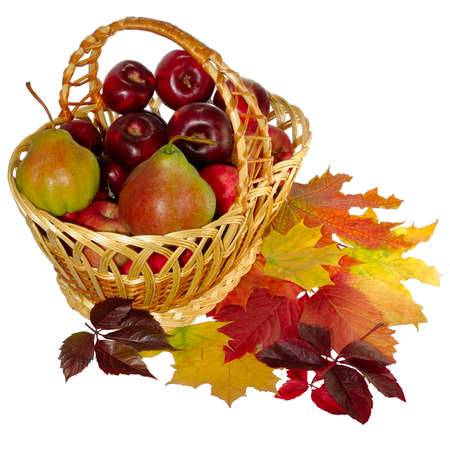 Isolated image of  basket with fruit and autumn leaves