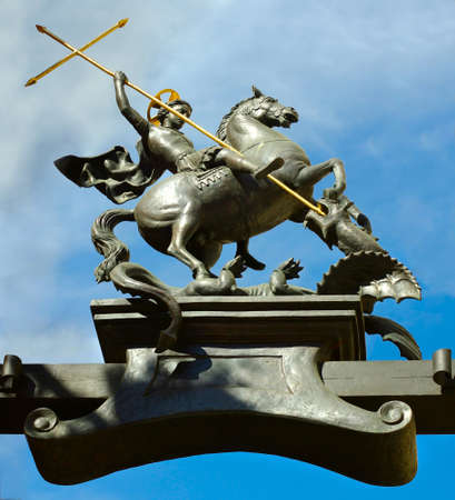Image of the monument of Saint George the victorious and the dragon against the sky.Monument is located in Kharkov (Ukraine)  photo